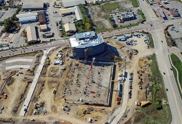 Looking S at new UIHC Clinic and parking ramp under construction along E. 9th Street in Iowa River Landing.