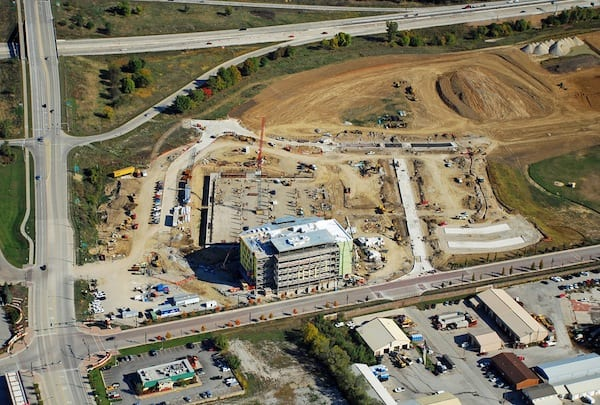 Looking N at the Iowa River Landing. New UIHC Clinic, parking ramp, and streets under construction. E. 9th Street in foreground. 1st Avenue left. Interstate 80 across top.