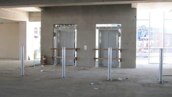 Installing Southeast elevator doors in parking garage
